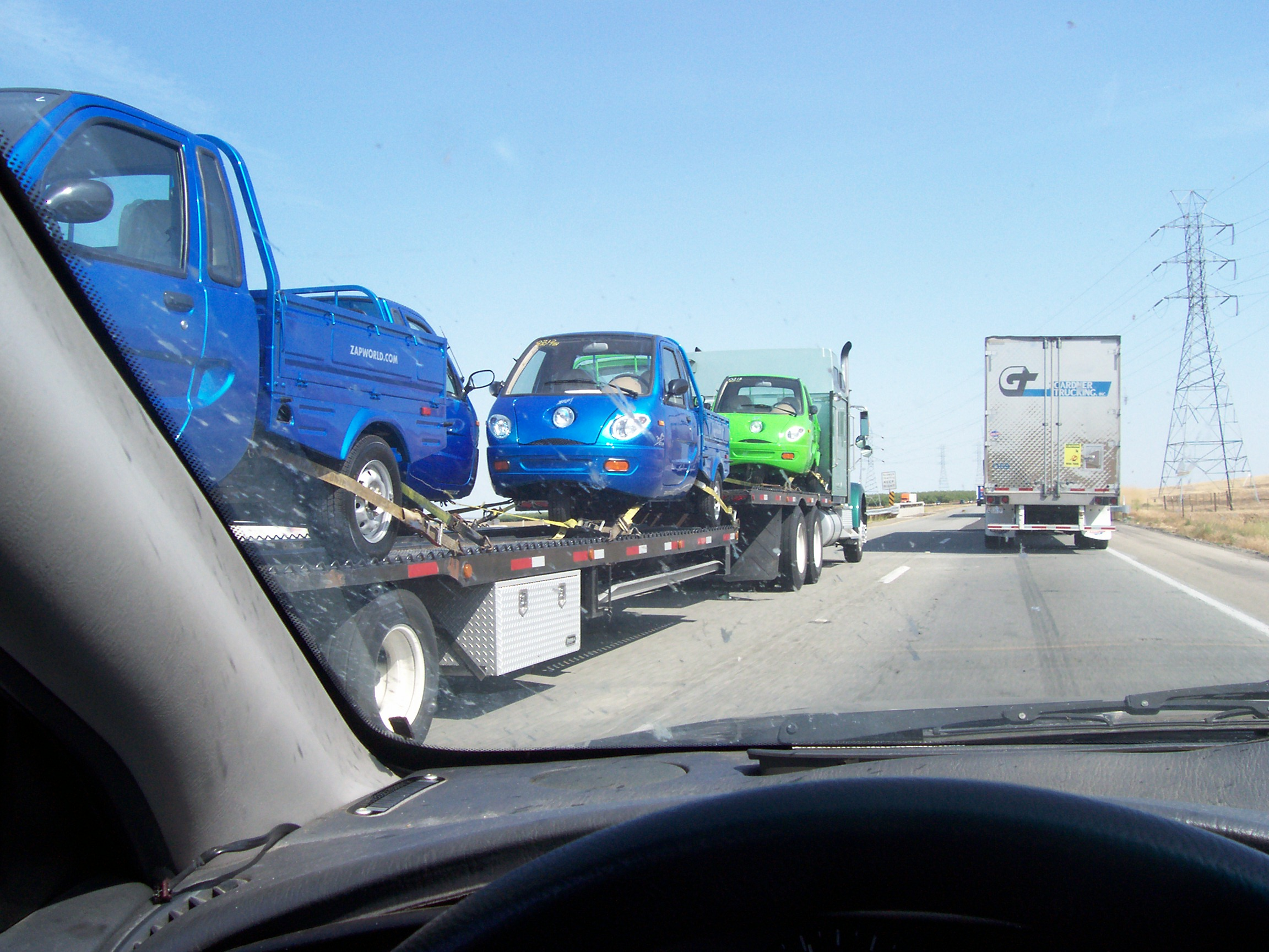 auto transporter hauling ZAP electric vehicles