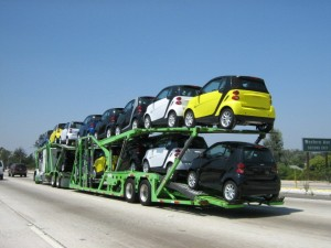 14 Smart cars on an auto transporter