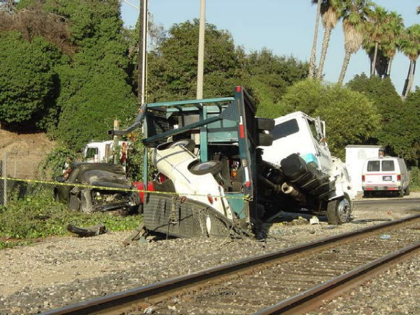 Car Hauler Trailer Severed In Two By Locomotive