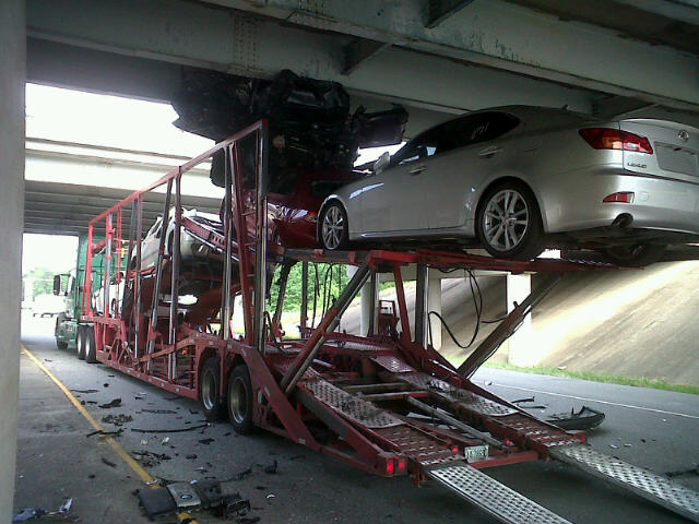 car carrier collides with bridge
