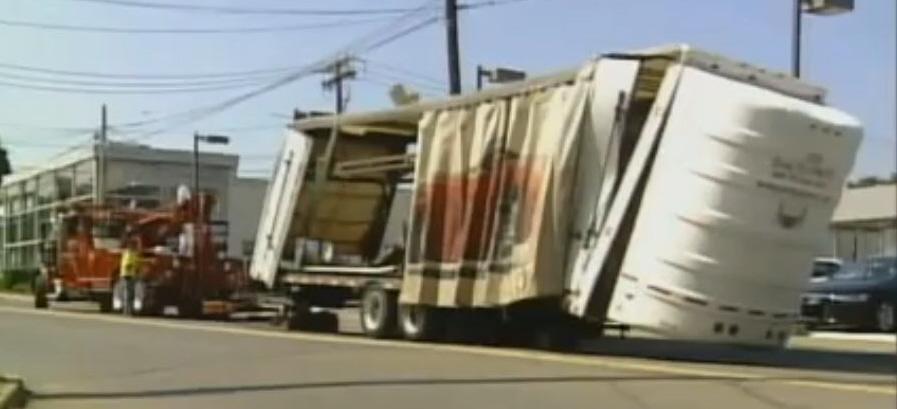 enclosed car carrier after bridge wreck