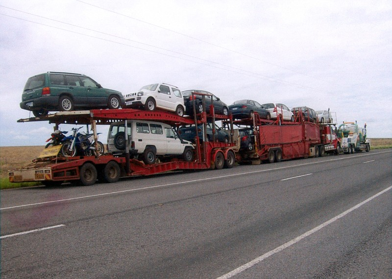car carrier auto transport road train getting towed