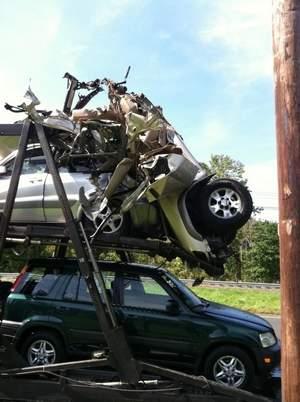 Mega Carrier auto transport hits bridge