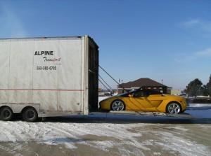 alpine auto transport enclosed carhauler loads expensive car