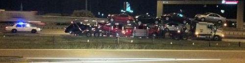 bridge knocks van off of the back of auto transporter