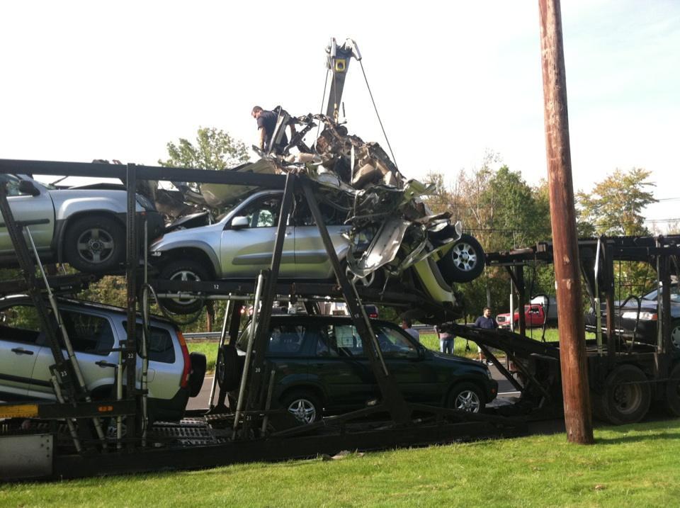 NJ auto transporter hits bridge
