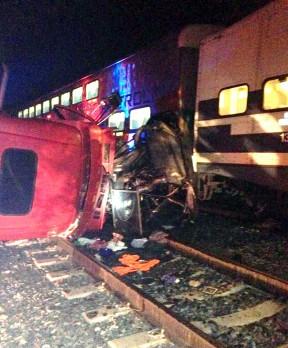 Train destroys car hauler auto transport truck