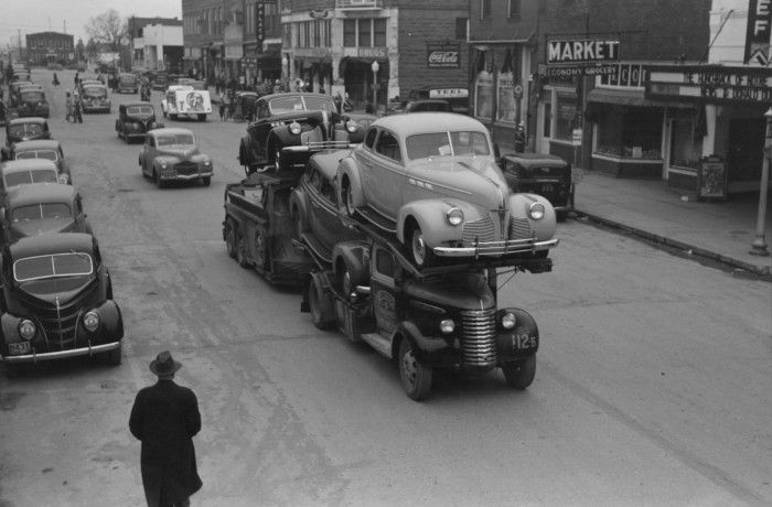 old auto transporter delivering new cars in 1940