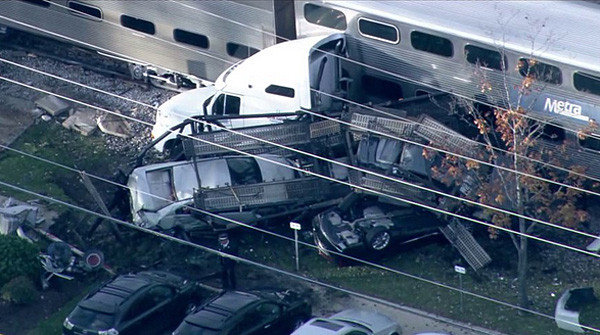 metra train vs auto transport truck1